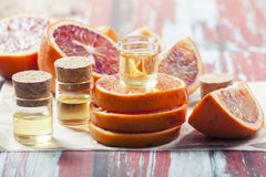 Essential oil citrus  with orange slices,  in glass bottle on ol Stock Photography