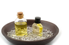 Essential oil and crystal. Rough stones in the earthenware plate Royalty Free Stock Photo