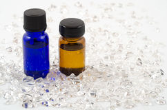 Essential oil and crystal. Essential oil and spread crystal rough stones Stock Photo