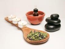 Essential oil. Essentisl oil with hot stones Stock Image