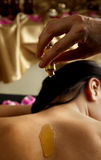 Essential oil female back spa Royalty Free Stock Photo