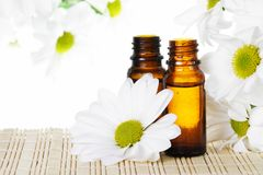 Essential Oil with Flowers Stock Photos