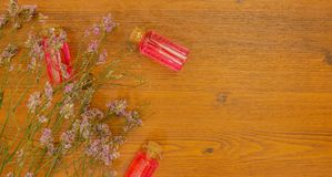 Essential oil in glass bottle stock photo