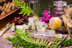 Essential oil and herbals in glass bottles Stock Photo