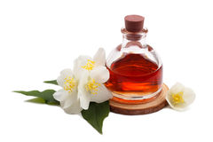 Essential oil with jasmine flower. Isolated over white stock image