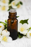 Essential oil with jasmine flower Stock Photos
