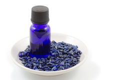 Essential oil and lapis lazuli. Gemstone on the plate Royalty Free Stock Photography