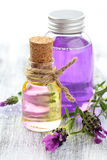Essential oil and lavender. Aromatherapy spa background with a sprig of fragrant lavender with essential oil and plant extracts with copyspace stock photos