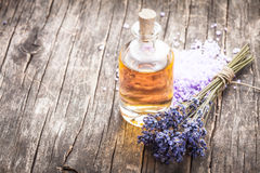 Essential oil. With lavender flower and seasalt - spa concept Stock Photos