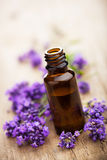 Essential oil and lavender flowers Stock Photo