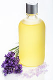 Essential oil and lavender flowers over white Stock Photo