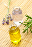 Essential oil with lavender and rosemary Stock Photos