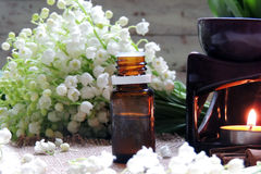 Essential oil and Lily of the valley Stock Images