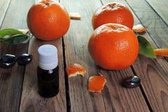 Essential oil and Mandarin Stock Photo