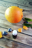 Essential oil and Mandarin Stock Images