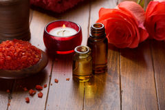 Essential oil, Mineral bath salts, candle and flowers Royalty Free Stock Photos