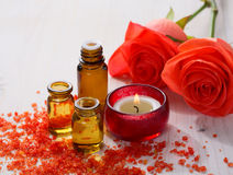 Essential oil, Mineral bath salts, candle and flowers Stock Image