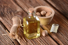 Essential oil of nutmeg. In the glass bottle royalty free stock images