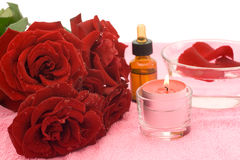 Essential oil and rose Stock Photo