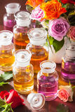 Essential oil and rose flowers aromatherapy spa perfumery Royalty Free Stock Photo