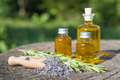Essential oil with rosemary and lavender flowers Stock Photo