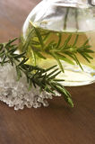 Essential Oil with rosemary and salt Stock Photography