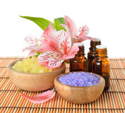 Essential oil, sea salt and flowers Stock Photography