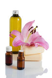 Essential oil, soap, lily, massage oil. Oil and lily on white background royalty free stock photography
