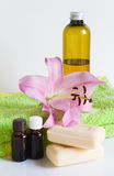 Essential oil, soap, lily, towels. Stock Image