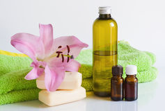 Essential oil, soap, lily, towels. Royalty Free Stock Images