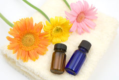 Essential oil on the yellow towel. With gerbera daisy Royalty Free Stock Image