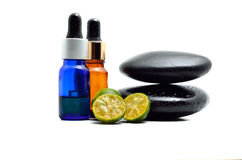 Essential oil with zen stone Stock Photography