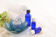 Essential oils. With Aromatherapy candle stock photos