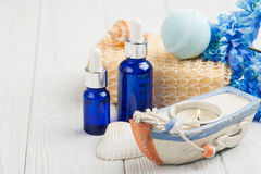 Essential oils, bath bomb, sponge, blue flowers Stock Image