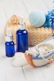 Essential oils, bath bomb, sponge, blue flowers Royalty Free Stock Image