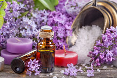 Essential oils and bath salt. With a background of lilac stock photos