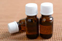 Essential oils. Bottle of essential oils on the table Royalty Free Stock Image