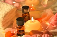 Essential oils in candle light Royalty Free Stock Photography