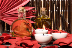 Essential oils and candles Stock Images