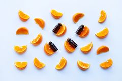 Essential oils with citrus fruits on white. Background stock photography