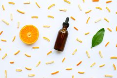 Essential oils with citrus fruits on white. Background royalty free stock photos