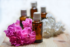 Essential oils. An essential oils composition with flowers stock photo