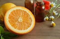 Essential oils with fruits. Fruits with essential oils and herbs royalty free stock photos