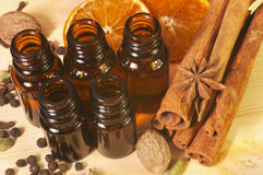Essential oils in glass bottles and spices Royalty Free Stock Photos
