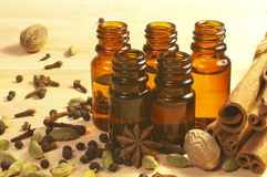Essential oils in glass bottles and spices Royalty Free Stock Photo