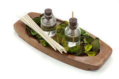 Essential oils with green leaf on wooden board Royalty Free Stock Photos