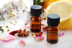 Essential oils with herbs and lemon royalty free stock images