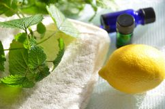 Essential oils with lemon. Essential oils for aromatherapy treatment with lemon and herb royalty free stock image