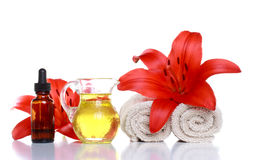 Essential Oils, Lillies and Towels Royalty Free Stock Photo