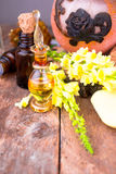 Essential oils and medical flowers herbs on wood Stock Photos